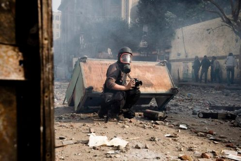 Hundreds of journalists have been killed reporting on conflicts throughout the world. EPA/Julien De Rose